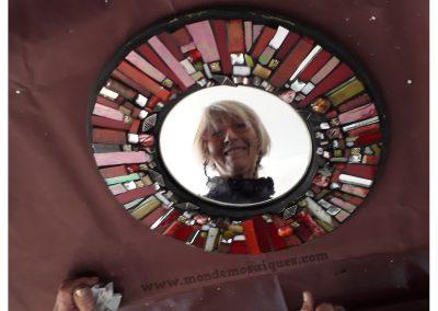 Espejo redondo con vidrios